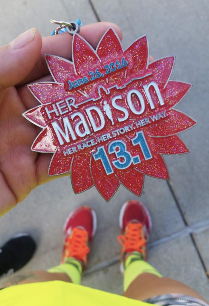 Her Madison Half Marathon Medal